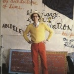Dennis Tourbin in his studio in Paris, France with painted text from Paris, La Nuit, A Painted Play, 1982. © Nadia Laham, 1982.