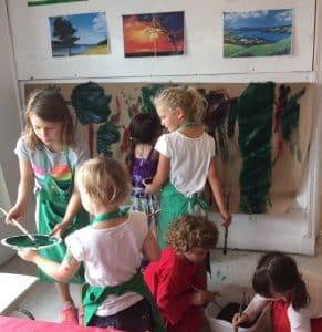 kids painting in the studio