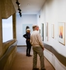 visitors looking at art in gallery ramps
