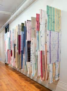installation of vertically hanging fabrics