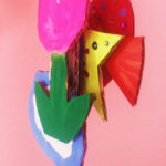 Three dimensional cardboard collage of a pink tulip and yellow star