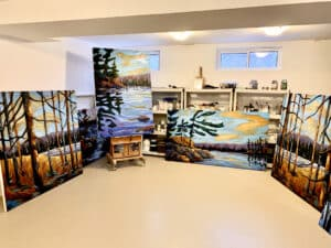 Carlo Allion's studio, with several landscape paintings