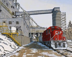 Red Canadian Pacific train in a docking station, with snow on the ground