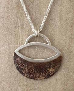 Bronze, sterling silver and gold pendant