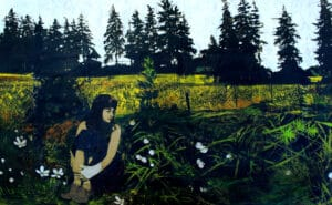 woman sitting alone in the grass