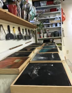 several artworks on a table drying