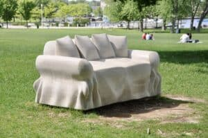 close view of carved limestone loveseat in park by Ernest Daetwyler