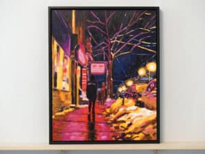 evening scene featuring person walking along sidewalk with storefronts and streetlamps