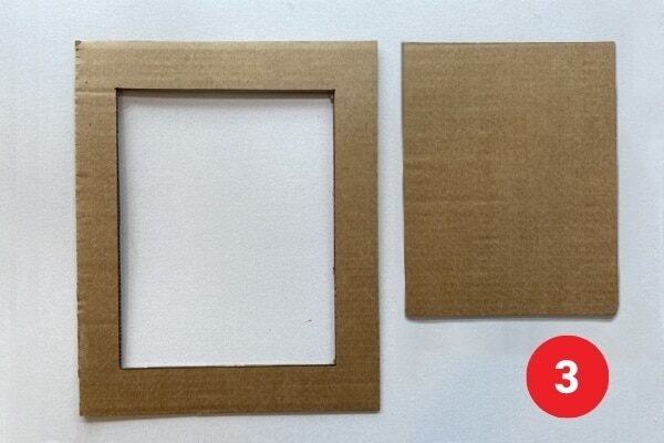 """A piece of cardboard with centre cut out making a rectangular frame. Text reads """"3."""""""
