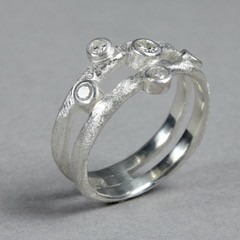 Hand carved sterling silver ring by Sandy MacFarlane featuring 5 diamonds
