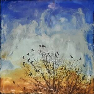 Encaustic painting featuring a silhouette of a barren tree with a murder of crows. Blue, yellow, and brown swirled background.